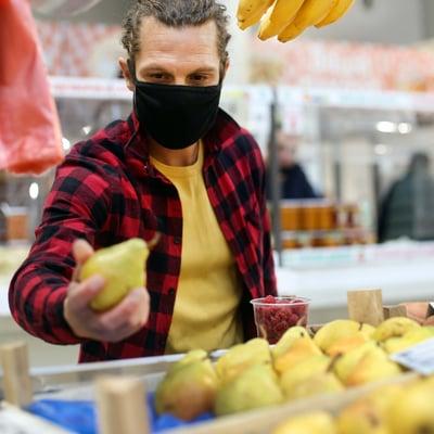 Man wearing mask for COVID-19 IQ Credit Union